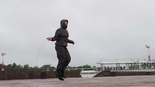 Thumbnail for A Man Does Exercises for Weight Loss - Jumping Rope.