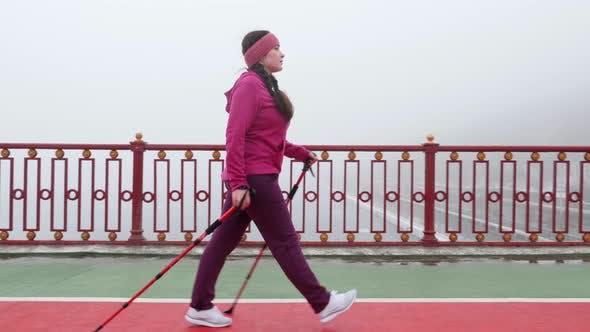 Nordic Walking Concept. Young Chubby Caucasian Woman Hiking with The Nordic Poles