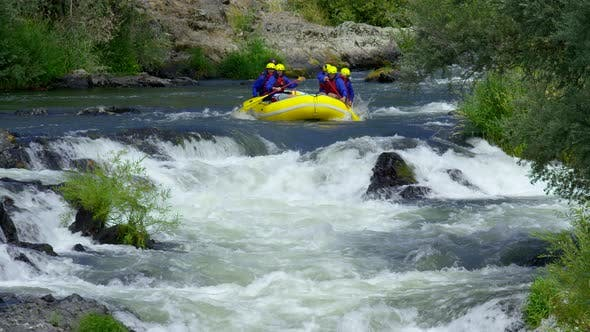 Thumbnail for Group of people white water rafting in slow motion