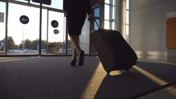 Thumbnail for Business Lady Going From Airport with Her Luggage. Woman in Heels Walking with Her Suitcase