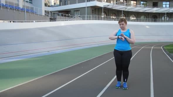 Thumbnail for Woman Jogger Using Fitness Bracelet During Running