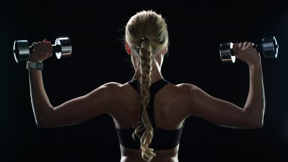 Thumbnail for Sport Woman Training with Dumbbells in Slow Motion. Fitness Girl Exercising
