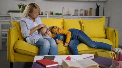 Loving Mother Consoling Her Upset Daughter on Sofa