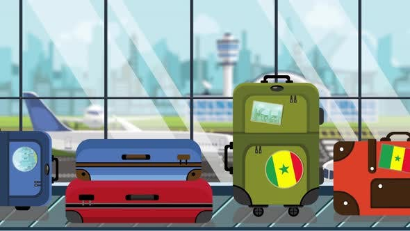 Suitcases with Senegalese Flag Stickersin Airport