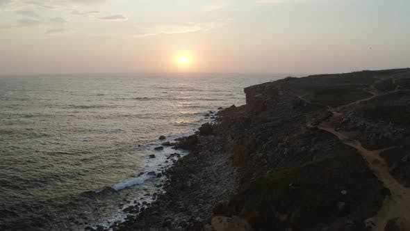 Thumbnail for Aerial View of the Coastline and Cliffs During Sunset Near the City of Peniche. Portugal in the