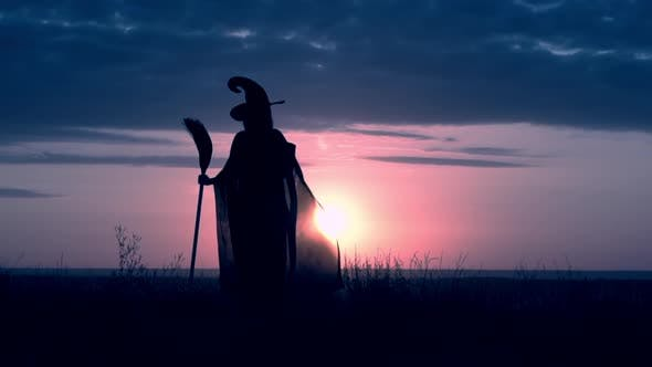 Thumbnail for Girl in Fancy Dress Sorceress Conjures with Magic Wand Sunrise View