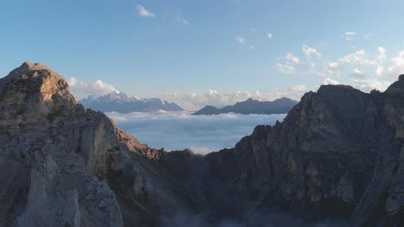 Thumbnail for Aerial Shot of Caucasus Mountain Peaks Above Clouds at Sunset
