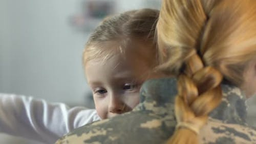 Happy Daughter Hugging Mother in Military Uniform, Family Relations, Homecoming
