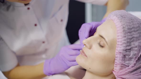 Thumbnail for A Specialist in Aesthetic Cosmetology Holds a Syringe in Her Hand