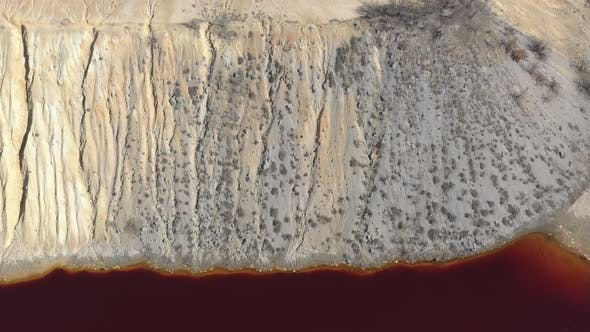 Thumbnail for Pyrite from open-pit mine site and red acidic drainage 4K aerial video