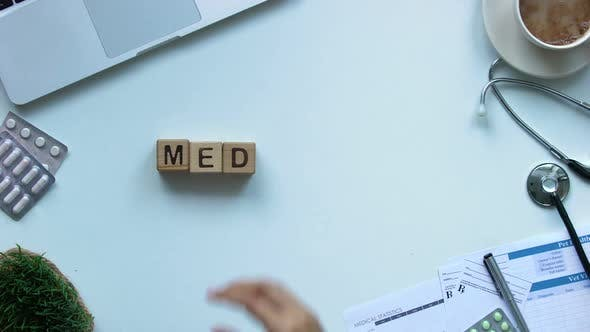 Thumbnail for Medicine, Womans Hand Making Word of Wooden Cubes, Healthcare Reform, Top View