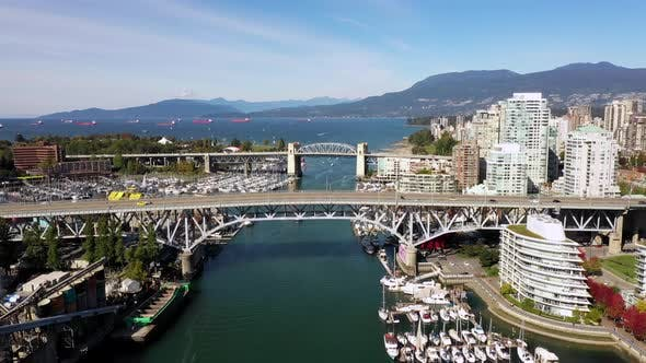 Thumbnail for Aerial Drone Fligh Above Vancouver Downtown Bridges and Yachts Marina, Canada