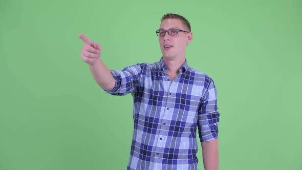 Thumbnail for Happy Young Hipster Man Pointing Finger