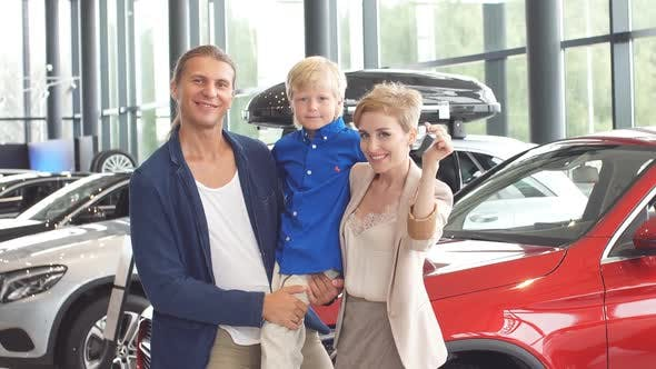 Thumbnail for Automobile Sales Centre. Young Family with Child Boy in Car Selling Club