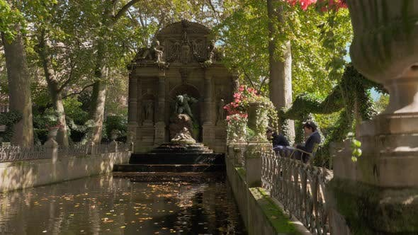 Scene with Medici Fountain in Luxembourg Gardens Paris, France