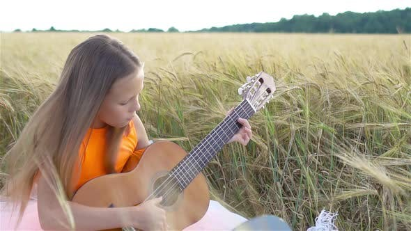 Thumbnail for Happy Cute Girl in Wheat Field Outdoors
