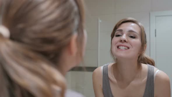 Thumbnail for Young Woman Checking Her Teeth in Mirror
