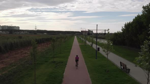 Thumbnail for Woman is cycling on cycle path near promenade. Happy girl is on bicycle.