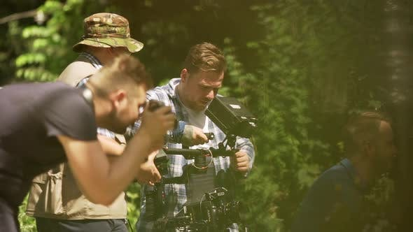 ODESSAUKRAINE 06212017 a Crowd of People on Backstage of Shooting Working with Camera and Other
