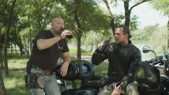 Thumbnail for Brutal Bikers Drinking Beer Near Motorbike in Park