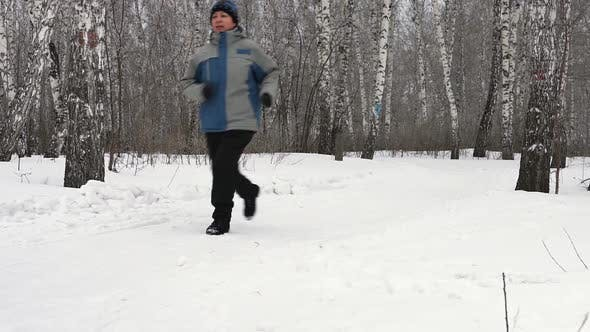 Thumbnail for Adult Woman Is Running Through The Forest