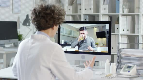 Thumbnail for Doctor Talking to Male Patient by Internet