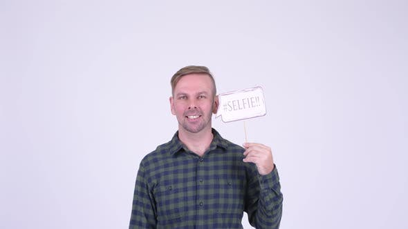 Thumbnail for Portrait of Happy Blonde Hipster Man with Selfie Paper Sign
