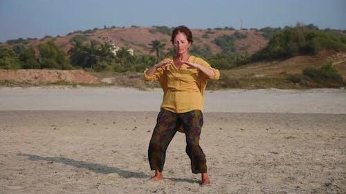 Senior Woman Practicing Taiji Gymnastic Outdoor