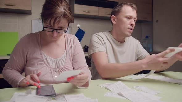 A Married Couple Is Counting Expenses on Checks a Man Is Shocked