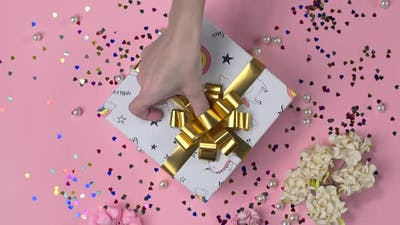 Gluing the Bow To the Present Box, Wrapping the Present, Parcel Decoration, Box with Presents