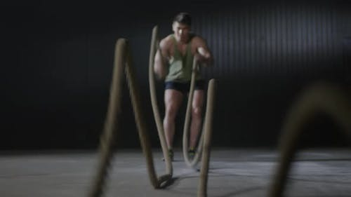 Sportsman Training with Battle Ropes