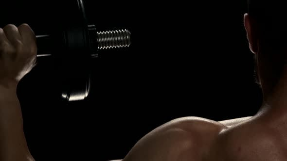 Lifting Dumbbells for Bigger Biceps Close Up.