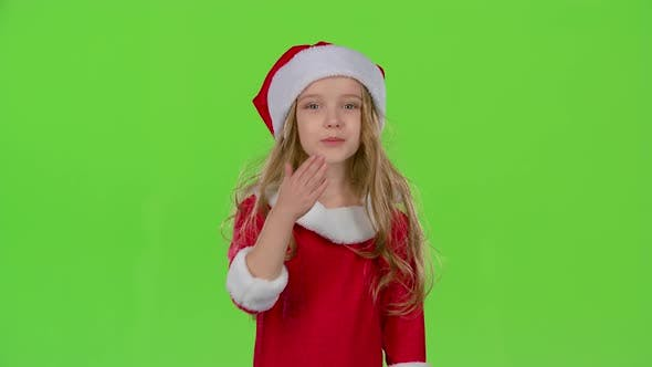 Thumbnail for Baby Girl in Red Christmas Caps Send Air Kisses, Green Screen