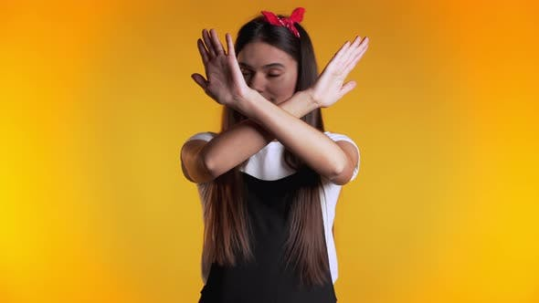 Girl Disapproving with No Crossing Hands Sign Make Negation Gesture. Denying