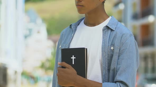 Thumbnail for Upset Boy Holding Bible, Thinking Over Religious Righteous Life