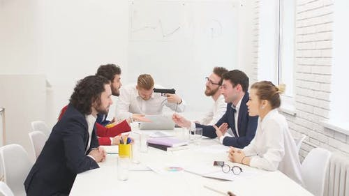 Unhappy Swearing Business People in Group Meeting in Office