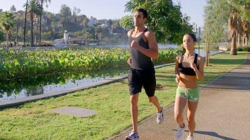 Athlete Couple Jogging