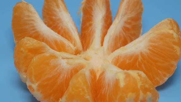 Tangerine Slices Rotate in a Plane