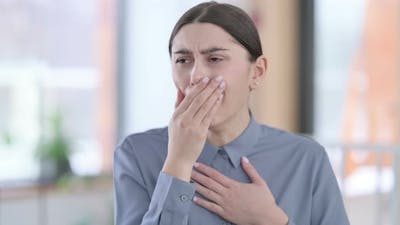 Portrait of Sick Young Latin Woman Coughing
