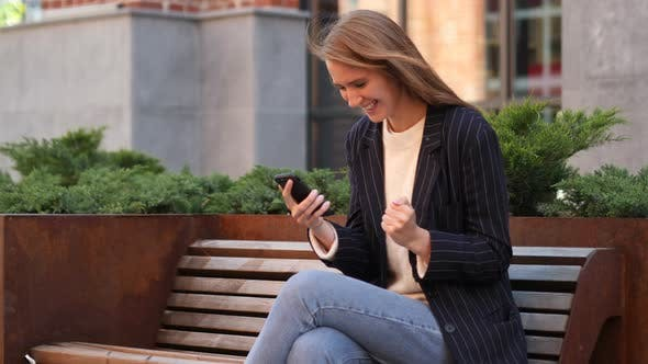Thumbnail for Businesswoman Celebrating Success while Using Smartphone