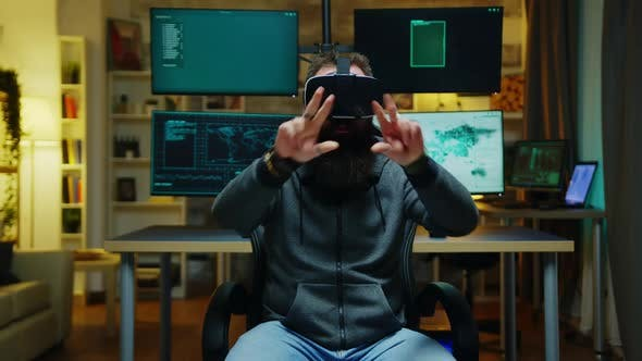 Thumbnail for Bearded Hacker Wearing a Virtual Reality Goggles