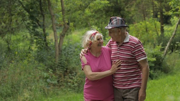 Thumbnail for Senior Caucasian Couple Walking in Park Embracing. Elderly Man Walks with Woman. Husband, Wife