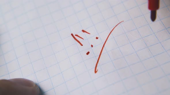 Man Writes Exclamation Marks with Red Marker on Paper Macro