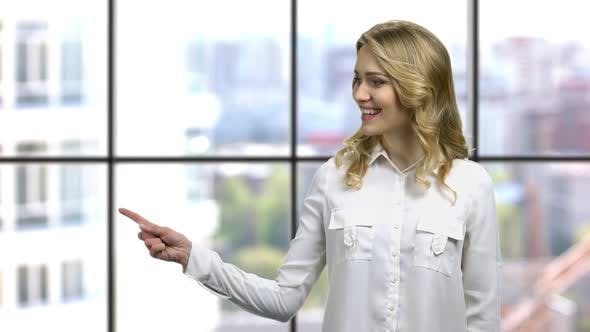 Attractive Business Woman Pointing at Copy Space