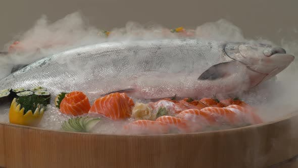 Thumbnail for Variety of fresh sushi and whole Salmon on ice.