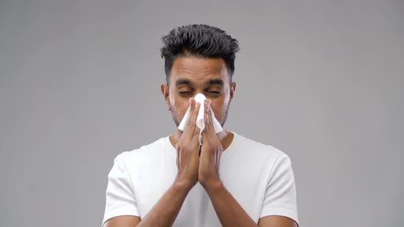 Thumbnail for Indian Man with Paper Napkin Blowing Nose 33