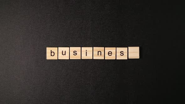 Thumbnail for Wooden Cubes Open And Sets Up A Word Business