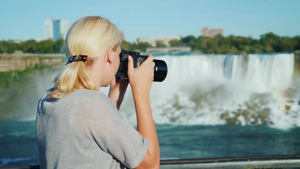 Thumbnail for A Woman Tourist Takes Pictures of the Famous Niagara Falls