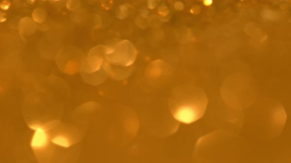 Thumbnail for Glittering Golden Particles With Bokeh. Yellow Gold Defocused Circular Facula. Natural Floating