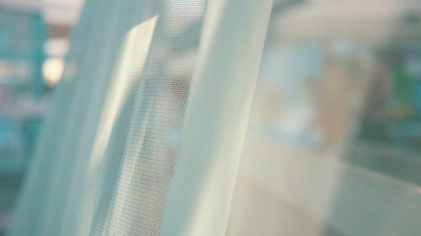 Thumbnail for See-through Blue  Veil Fluttering on a Canopy on a Seashore in Slow Motion
